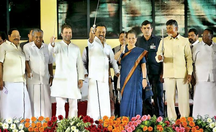 UPA Chairperson Sonia Gandhi, Congress President Rahul Gandhi, DMK chief M K Stalin, Andhra Pradesh Chief Minister N Chandrababu Naidu and Kerala Chief Minister Pinarayi Vijayan with swords that were presented at the public meeting after unveiling of bronze statue of M Karunanidhi in Chennai on Sunday. DH Photo