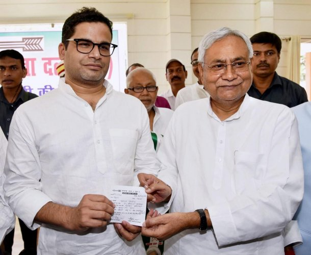 Bihar Chief Minister and Janta Dal United JD(U) National President Nitish Kumar greets electoral strategist Prashant Kishor after he joined JD(U) during party's state executive meeting at Anne Marg, in Patna, Sunday, Sept 16, 2018. (PTI Photo)