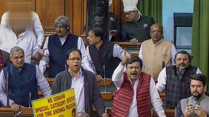 BJP members react on the Supreme Court's verdict on Rafale issue, in the Lok Sabha during the Winter Session of Parliament, New Delhi, Friday, Dec 14, 2018. (LSTV GRAB via PTI