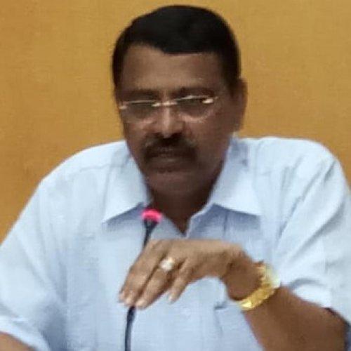 Deputy Commissioner M K Srirangaiah