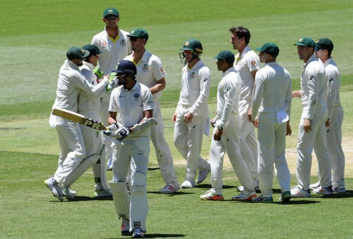 Batsman Ishant Sharma walks back to the pavilion after his dismissal as Australian players celebrate during day five of the second Test cricket match between Australia and India in Perth on December 18, 2018. (Photo AFP)
