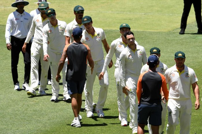 India's captian Virat Kohli (C) shakes hands with Australian players at the end of second Test cricket match between Australia and India in Perth on December 18, 2018. (Photo AFP)