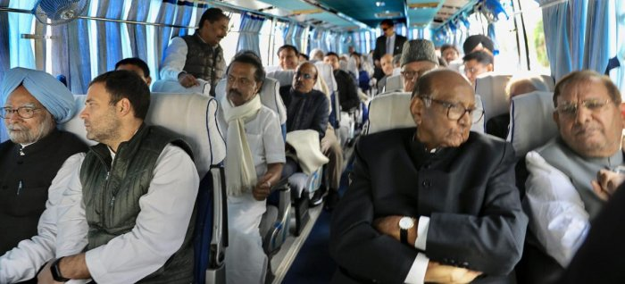 Congress President Rahul Gandhi (2nd L), former prime minister Manmohan Singh (L), NCP chief Sharad Pawar (2nd R), Loktantrik Janata Dal chief Sharad Yadav (R) and other senior opposition leaders on their way to Albert Hall to attend the swearing-in ceremony of Ashok Gehlot government, in Jaipur, Monday, Dec. 17, 2018. (PTI Photo)