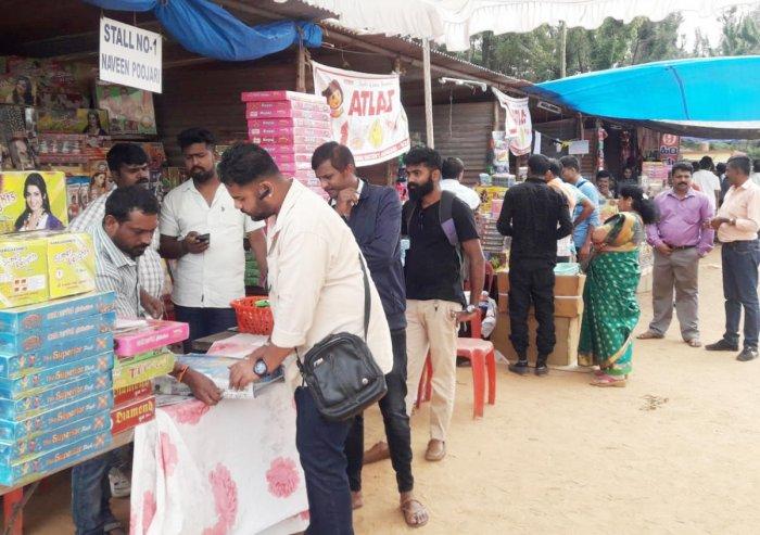 People purchase firecrackers for Huttari festival.