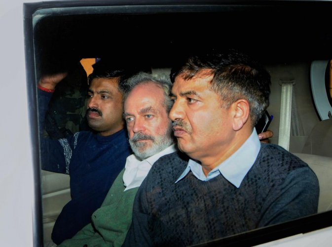 Christian Michel (C), the alleged middleman in the multi-crore AgustaWestland chopper deal, being produced at a CBI court in Patiala House Court in New Delhi. PTI Photo
