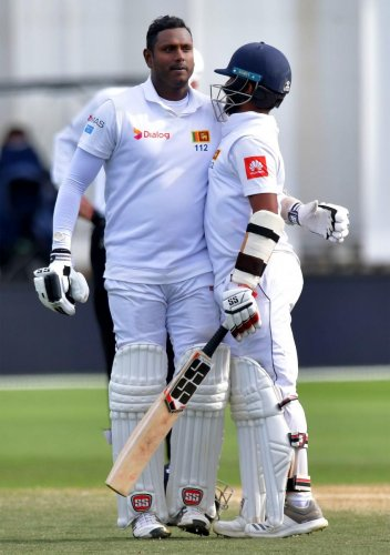 ROCK SOLID: Sri Lanka's Angleo Mathews celebrates his century with team-mate Kusal Mendis during the fourth day of the first Test against New Zealand in Wellington. AFP