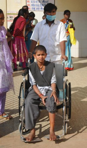 Rakshitha, a student who was bitten by a stray dog, was shifted to the hospital in a wheelchair.