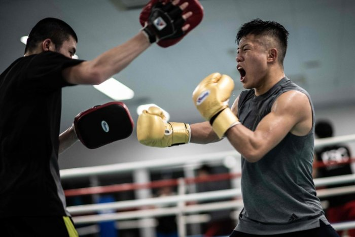 This picture taken on December 7, 2018 shows Yudai Shigeoka (R), captain of the Takushoku University boxing team, attending a training session at the university in Hachioji. - The International Olympic Committee said this month it was suspending preparati