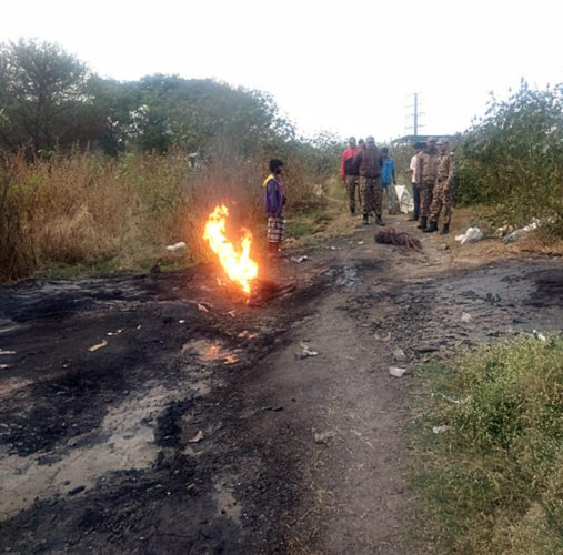 Marshals catch hold of offenders who were burning cables near Bellandur Lake to extract copper.