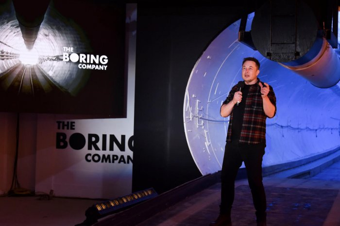 "Tesla Inc. founder Elon Musk speaks at the unveiling event by ""The Boring Company"" for the test tunnel of a proposed underground transportation network across Los Angeles County, in Hawthorne, California, U.S. December 18, 2018. Robyn Beck/Pool via REUTER"