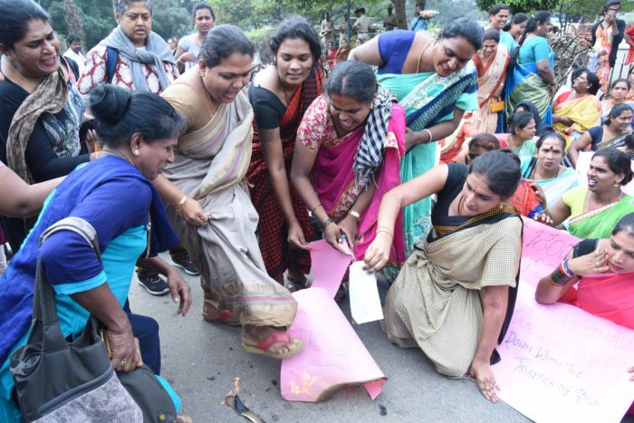 NEAR TOWN HALL Activists on Wednesday burnt a copy of the Transgender Persons (Protection of Rights) Bill