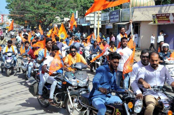 Vishwa Hindu Parishad and Bajrang Dal activists take out a bike rally in Chikkamagaluru on Wednesday.