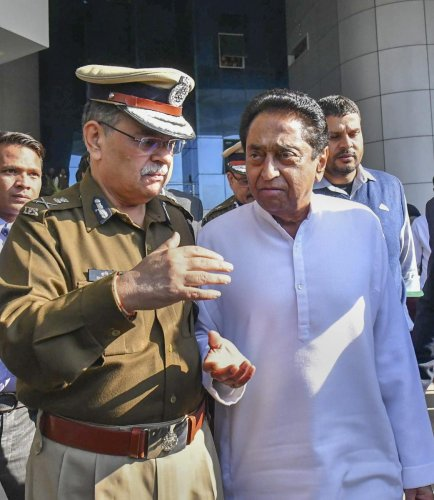 Madhya Pradesh Chief Minister Kamal Nath with DGP Rishi Kumar Shukla after meeting with senior police officials at the police hedquarters in Bhopal on Wednesday. PTI