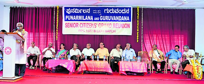 Retired lecturer of Poornaprajna College Udyavara Madhava Acharya speaks during the reunion of 1977 batch BCom students in Udupi.