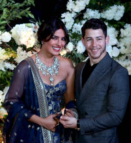 Bollywood actor Priyanka Chopra and American singer Nick Jonas pose for photos during their wedding reception Party in Mumbai on December 19, 2018. (PTI Photo)