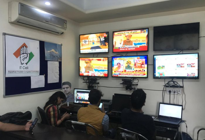 Volunteers of India's main opposition Congress party monitor TV news channels and social media inside their war room which was setup for a state assembly election, in Jaipur in the desert state of Rajasthan. Picture taken on December 3, 2018. (REUTERS/Aditya Kalra)