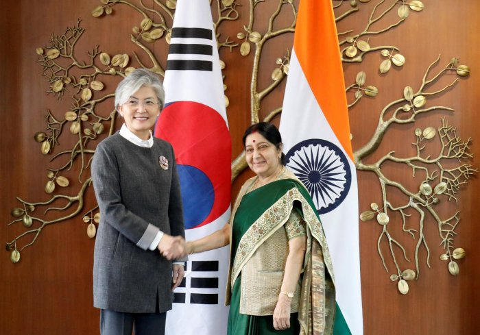 Foreign Minister Sushma Swaraj shakes hands with her South Korean counterpart Kang Kyung-wha in New Delhi on Wednesday. PTI