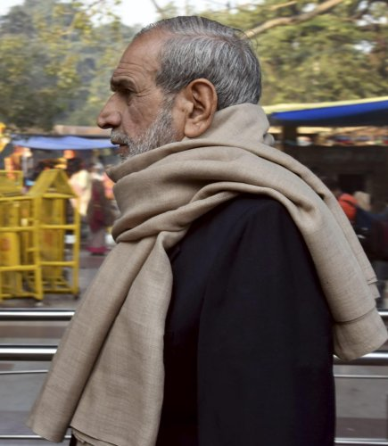 Congress leader Sajjan Kumar leaves after offering prayers at Hanuman temple in Connaught Place, in New Delhi. PTI