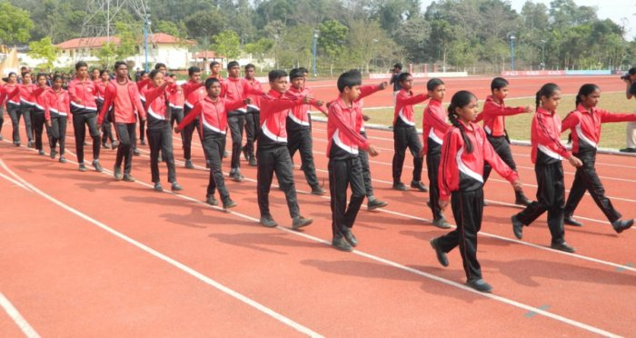 Participants take part in a march past at School Track and Field Championship, organised by Ashwini Sports Foundation, at CALS School grounds in Gonikoppa on Thursday.