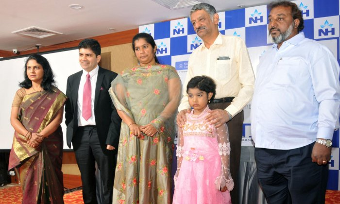 Syeda and her father seen with doctors, in Mysuru, on Thursday.