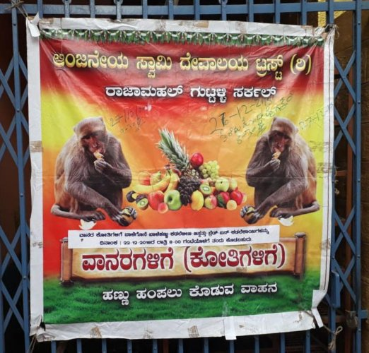 A poster inviting devotees to feed the monkeys displayed at the temple.