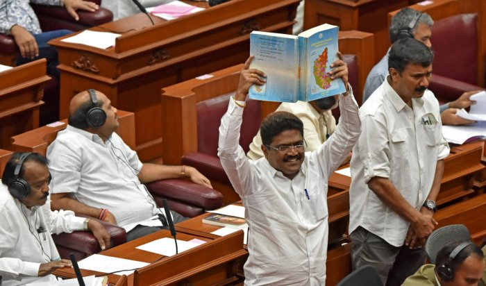 RAISING VOICE: BJP members stage a protest in the Legislative Council demanding a discussion on the problems faced by North Karnataka, during the legislature session in Belagavi on Friday. dh photo