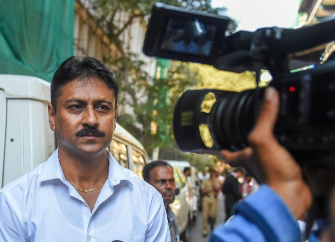 Ashish Pandya, then sub-inspector with the Gujarat Police accused of shooting Tulsiram Prajapati, leaves the special CBI court after being acquitted, in Mumbai on Friday. PTI