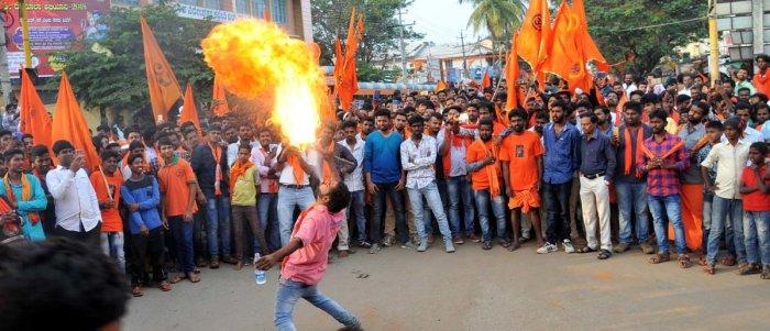 A Datta devotee exhibits a stunt during Shobhayatra in Chikkamagaluru on Friday.