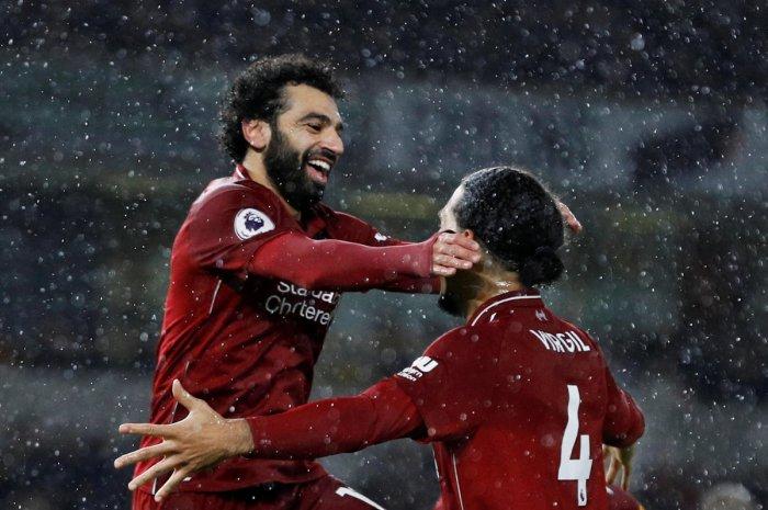 Liverpool's Mohamed Salah celebrates after scoring their first goal with Virgil van Dijk. (Reuters Photo)