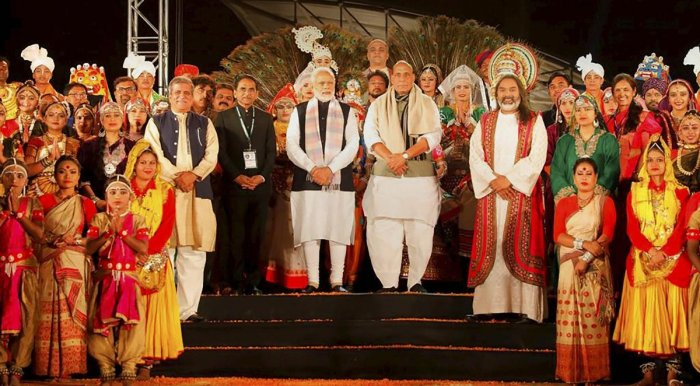 Prime Minister Narendra Modi and Home Minister Rajnath Singh pose for photos with a group of artists, in Kewadiya, Friday, Dec. 21, 2018. (PTI Photo)
