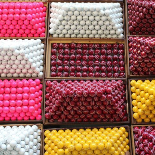 Balls used for different types of matches are exhibited after they have undergone the final stages of production and testing. (Photo: Kookaburra website)