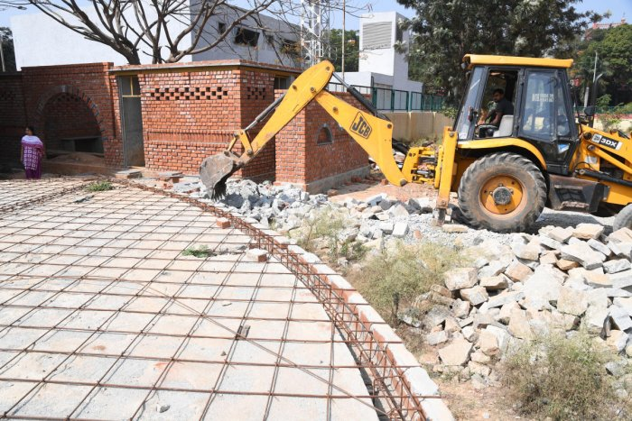 Rangamandira which is under construction at GAS college campus was being demolished by the GAS college authorities on Govt. direction in Bengaluru on Saturday. Photo: Srikanta Sharma R.