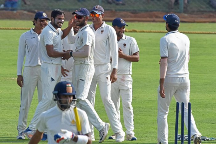 FINE EFFORT: Railways' Amit Mishra (second from left) celebrates with team-mates after a Karnataka wicket on the opening day of their Ranji Trophy match in Shivamogga on Saturday.DH PHOTO/ S K DINESH