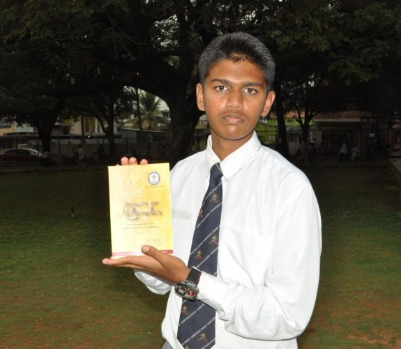 Sainik School student A Manish shows his book 'Beauty of Mathematics'.