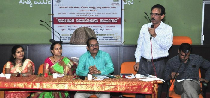 KUIDFC Assistant Executive Engineer Ramakrishnaiah speaks at a consultative meeting in Udupi.