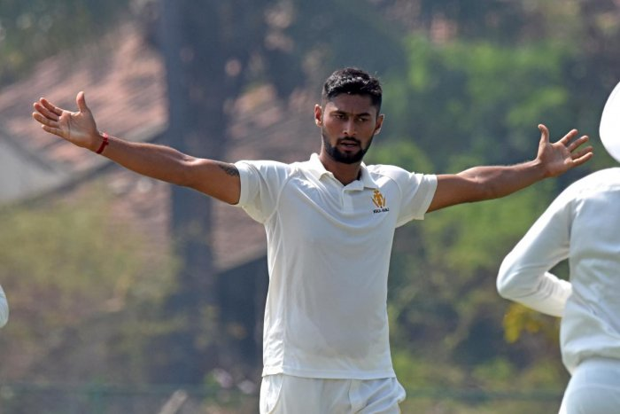 HIGH-FLYING: Karnataka's Ronit More celebrates after taking his second five wicket haul of the season during the game against Railways in Shivamogga on Sunday. The right-arm medium pacer bagged 5/45. DH Photo/ S K Dinesh