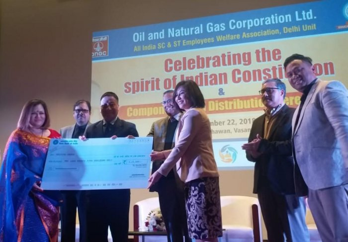 ONGC handing over a cheque to Helping Hands, an NGO, in New Delhi on Saturday. Photo by Robin Hibu, IGP