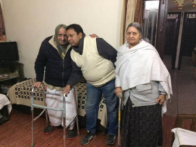 Sushil Kumar Sharma with his family members at his residence in New Delhi. (PTI Photo)