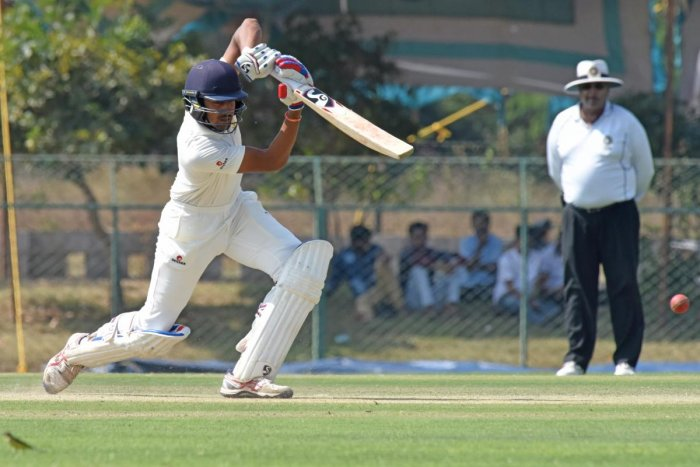 SOLID: Karnataka's D Nishcal en route to his century in the Ranji Trophy game against Railways in Shivamogga on Monday. DH photo/ S K Dinesh