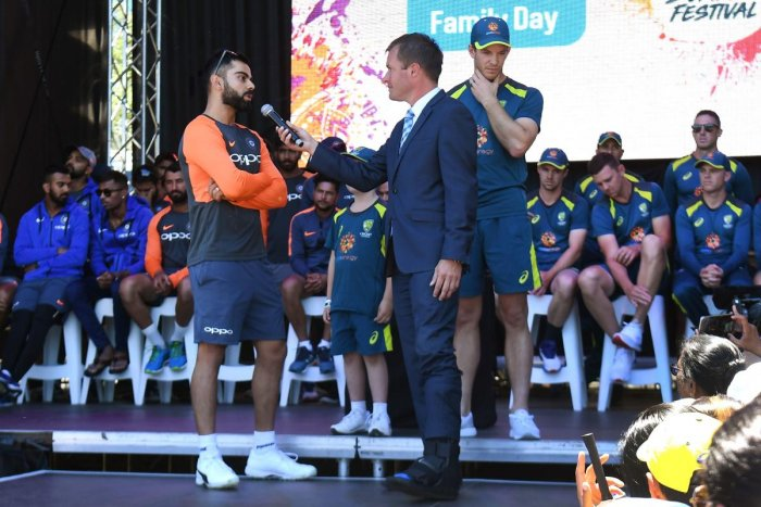 India's captain Virat Kohli (L) and his Australian counterpart Tim Paine (R) are interviewed during a meet the fans event in Melbourne on December 23, 2018, ahead of their third cricket Test match. (AFP Photo)