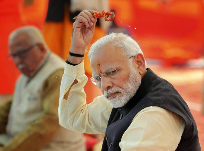 Prime Minister Narendra Modi, performs rituals at Sangam, the confluence of the Rivers Ganges and Yamuna, at Allahabad. PTI