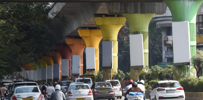 The bare advertisement panels on Metro pillars after the BBMP banned all hoardings. DH Photo/Janardhan B K