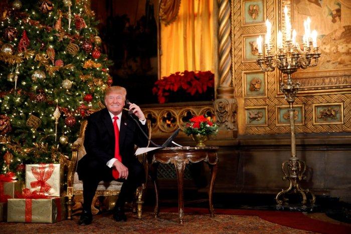 US President Donald Trump participates in NORAD (North American Aerospace Defense Command) Santa Tracker phone calls with children at Mar-a-Lago estate in Palm Beach, Florida, U.S., December 24, 2017. REUTERS