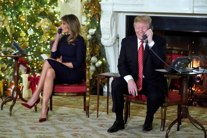 US President Donald Trump and first lady Melania Trump participate in NORAD Santa tracker phone calls from the White House in Washington on Monday. (REUTERS)