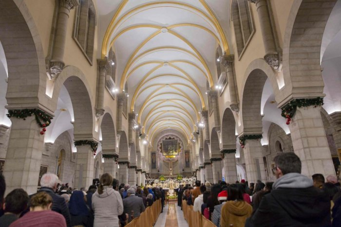 Archbishop Pierbattista Pizzaballa, the top Roman Catholic cleric in the Holy Land, heads a Christmas midnight mass at Saint Catherine's Church, in the Church of the Nativity, traditionally recognized by Christians to be the birthplace of Jesus Christ, in
