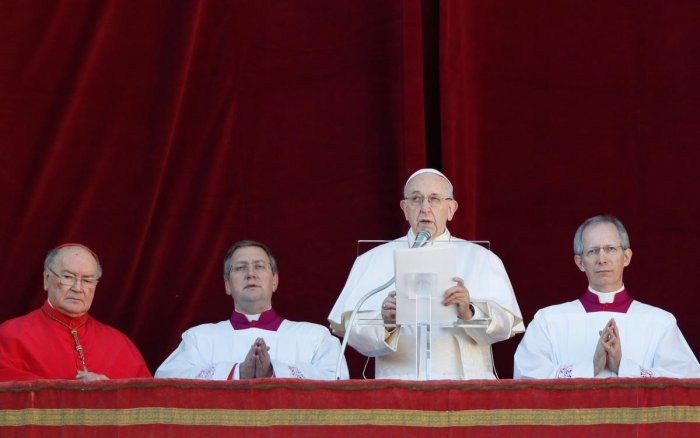 """Pope Francis delivers the """"Urbi et Orbi"""" message from the main balcony of Saint Peter's Basilica at the Vatican. Reuters"""
