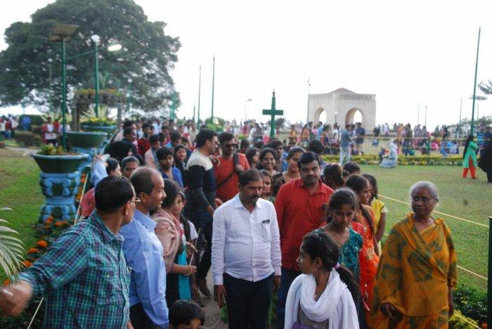 Tourists at Raja Seat in Madikeri on Tuesday.