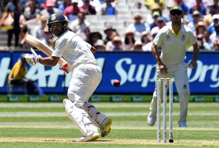 India's batsman Mayank Agarwal (L) plays a shot during day one of the third cricket Test match between Australia and India in Melbourne on December 26, 2018. (AFP Photo)