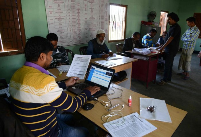 Employees of the National Register of Citizens (NRC) work in an NRC centre at Hatisola village in Kamrup district, Assam. (AFP File Photo)