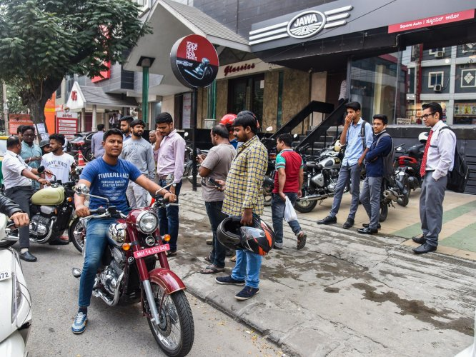 Bike enthusiasts test ride the new Jawa at the Koramangala outlet. DH PHOTO BY S K DINESH